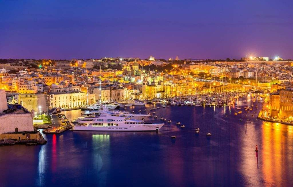 Grand harbour at night lit up